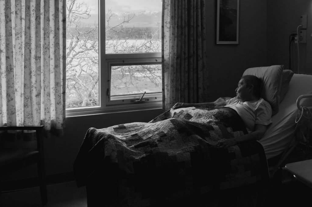 Alphena Franklin-Amor, a Resident in The Views, admires her view from her bed in Oceanview (McKinnon Photography).