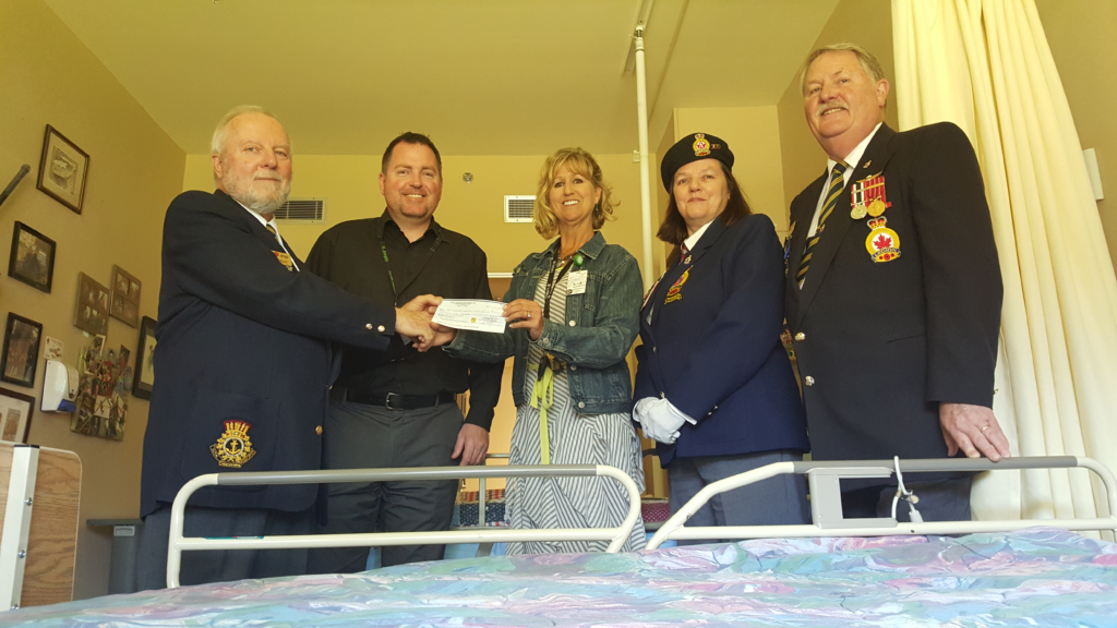 Royal Canadian Legion Branch 160 President Dave Kelly (left) and Poppy Chair John Paulin (far right) present a cheque for $5,000 to Michael Aikins, Manager of The Views and Lynn Dashkewytch, Executive Director of Comox Valley Healthcare Foundation.
