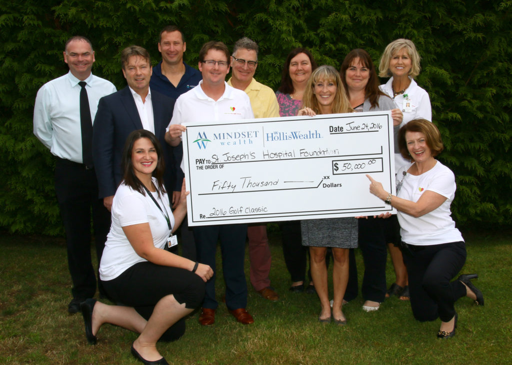 Committee members from the 26th Annual St. Joseph's Hospital Foundation Golf Classic present a cheque to the Comox Valley Healthcare Foundation (formerly St. Joseph's Hospital Foundation) and Jane Murphy, President & CEO of St. Joseph's Hospital. This year's golf event raised a record-breaking $52,000 to purchase a new Fluid Management System for the Operating Room. From left to right, back row: Cyriel DeBruyne, Russ Keil, Russ Wigle, Robert Mulrooney, Peter Diespecker, Randi Reid, Meghan Liddle, Laura Nickel, Lynn Dashkewytch. Bottom Row, Katie Maximick and Jane Murphy (Jim Peacock photo).