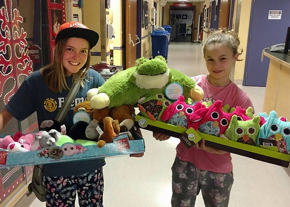 Brooklyn Elementary classmates Adria (left) and Brynn hold some of the stuffed animals they donated to kids at St. Joseph's Hospital as part of their Grade 5 Design for Change School Challenge last May.
