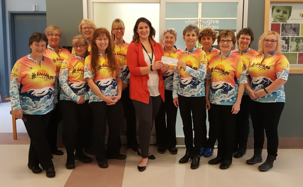 Teammates of the Hope Afloat Canada's dragon boat team present a cheque for $2,300 to the Comox Valley Healthcare Foundation on Friday, Oct. 28. Proceeds from their annual Tag Day go to the Cancer Care Unit at St. Joseph's Hospital.