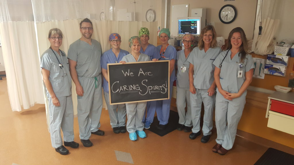 Dr. Tom Woods (second from left) and his Operating Room team were recipients of a Caring Spirit award for excellent patient care following two hip replacements this past Spring.