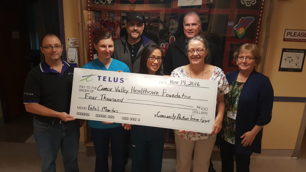 Comox Valley TELUS employees Jay (far left) and Mack (third from left) present a cheque for $4,000 to Maternal Child staff and Comox Valley Healthcare Foundation vice president Bill Anglin (third from right) and president Brenda Kelm (right) at St. Joseph's Hospital on Monday, Nov. 14.