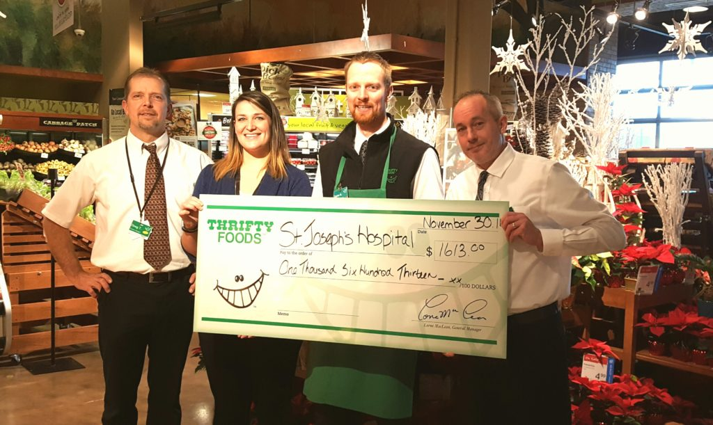 Produce staff and manager Jeff Ackinclose (right) from the Crown Isle Thrifty Foods present a cheque for $1,613 to Katie of the Comox Valley Healthcare Foundation. $1 from each pumpkin sold in October at both Courtenay Thrifty Foods locations went towards the purchase of new medical equipment for St. Joseph's Hospital.